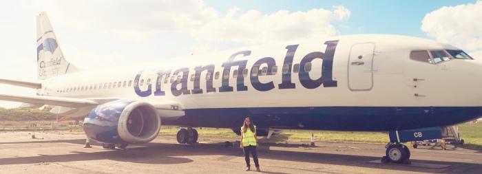 Cordelia standing next to a jet aircraft